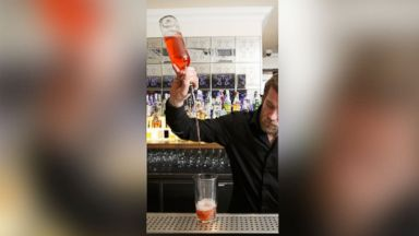 """PHOTO: A """"long pour"""" by a bartender."""