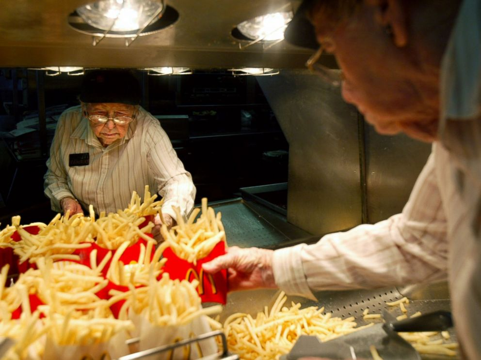 PHOTO: Dorothy Evans, 92, fills orders for french fries at the McDonalds in Dinuba, California, May 9, 2007. Dorothy says she has been working at McDonalds for 14 years. I was tired of sitting home, said Dorothy.