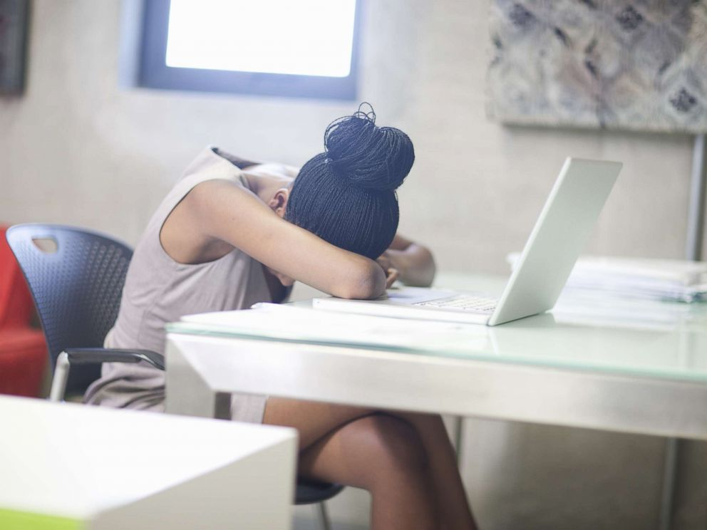 PHOTO: A woman puts her head down at work in an undated stock photo.