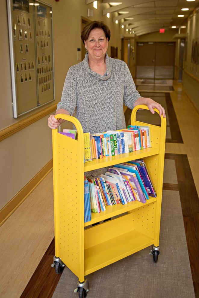 PHOTO: Suzy Guess stands by a book cart in the neo-natal intensive care unit at UPMC Magee-Womens Hospital.