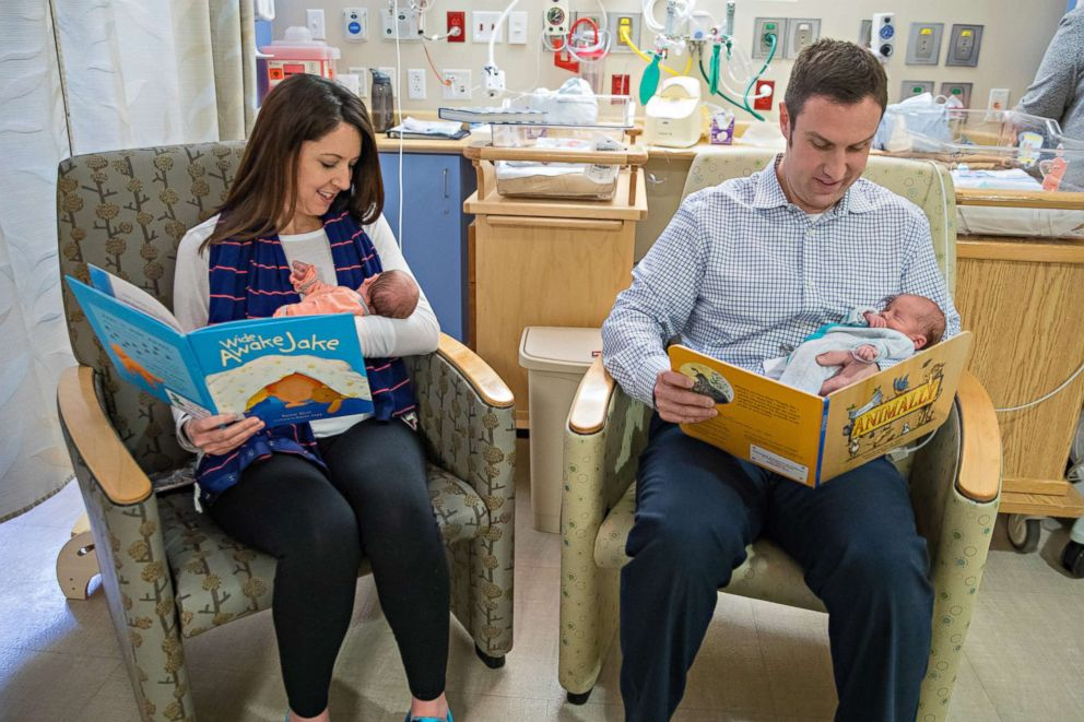 PHOTO: Brad and Kara Curran read to their twin sons in the neo-natal intensive care unit at UPMC Magee-Womens Hospital.