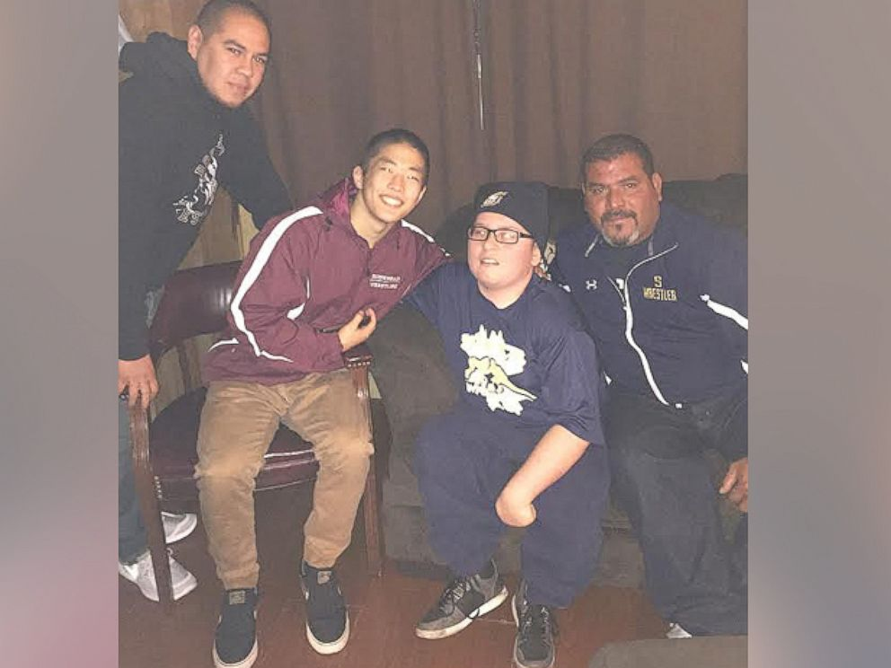 PHOTO:Photographed left to right, Rosemead High School coach Justin Fregoso, wrestlers Alex Masuda, 17 and Nick Haller, 17, and South El Monte High School coach Ray Castellanos.