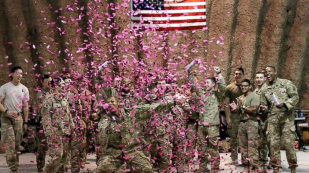 U.S. Army soldiers deployed in Afghanistan used pink confetti to reveal the gender of Brit and Chris Harris's baby.