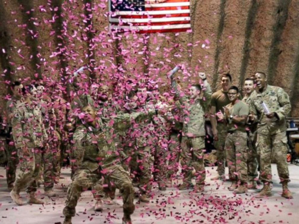 PHOTO: U.S. Army soldiers deployed in Afghanistan used pink confetti to reveal the gender of Brit and Chris Harriss baby.