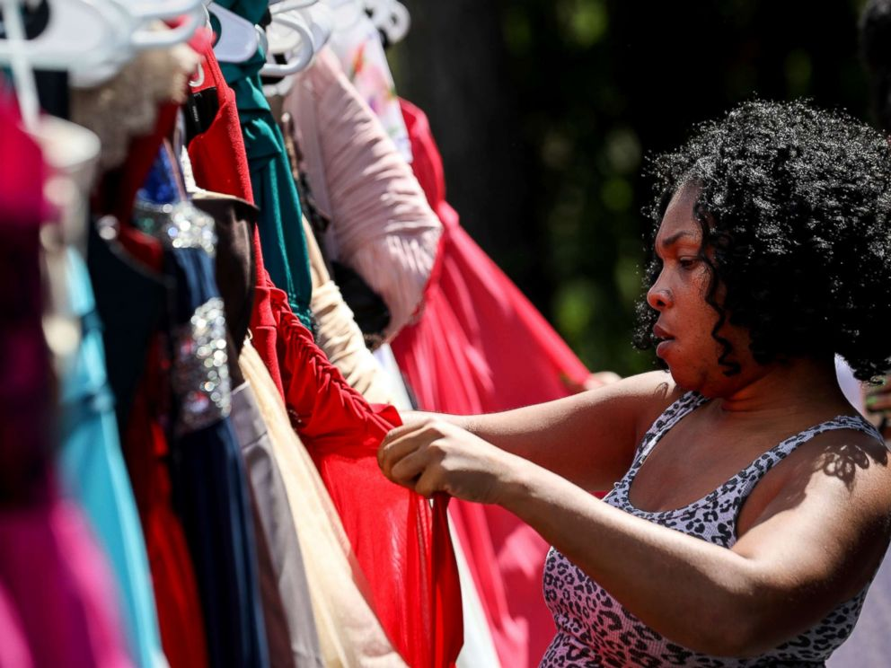 PHOTO: Shyra Moody looks for a homecoming dress for the daughter of a friend who lost everything in Hurricane Harvey, at the home of Tammy Reel, Sept. 24, 2017, in Spring, Texas.