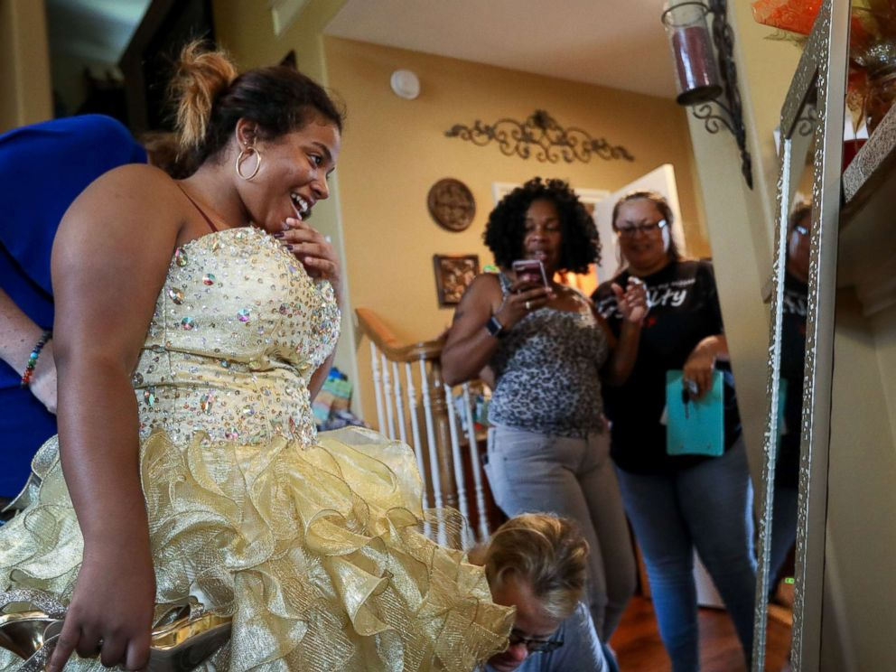 PHOTO: Ashley Reel of Spring, Texas, has collected over 2,000 evening dresses for high school students all over the Houston area who have been affected by Hurricane Harvey.