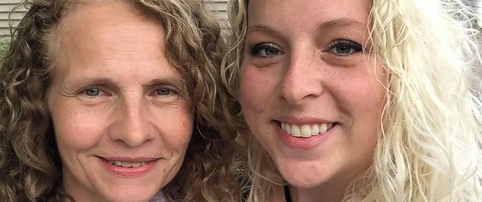 PHOTO: Hillary Harris, 31, poses with her long-lost sister, Dawn Johnson, 50, after they learned they lived next door to one another in Wisconsin.