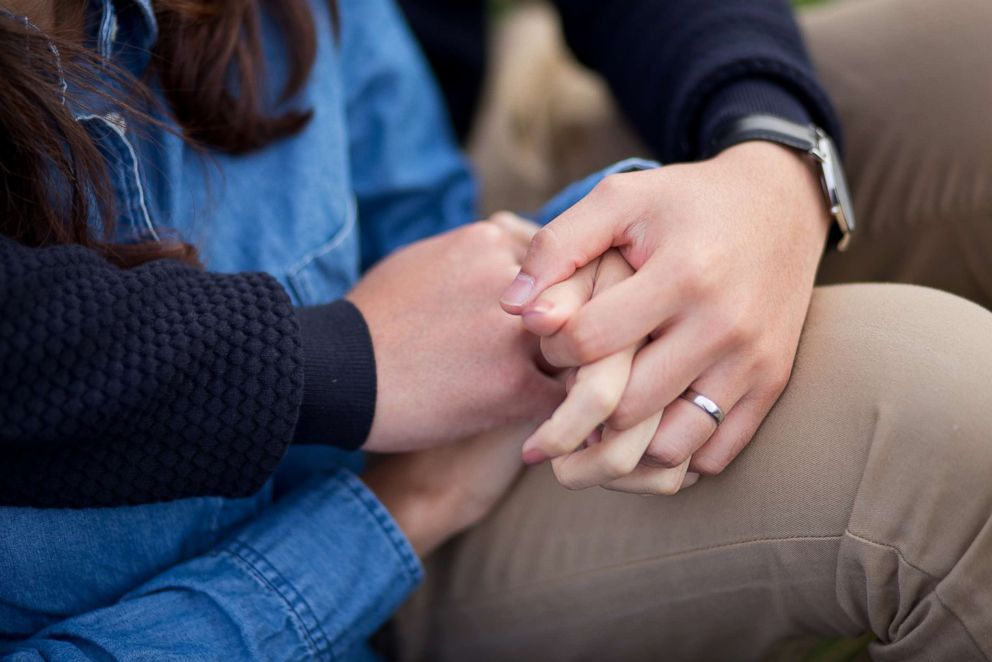Stock photo of a couple holding hands.