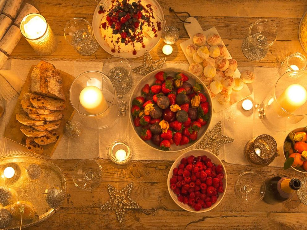 PHOTO: Overhead view of a candlelight table with Christmas desserts in this undated stock photo.