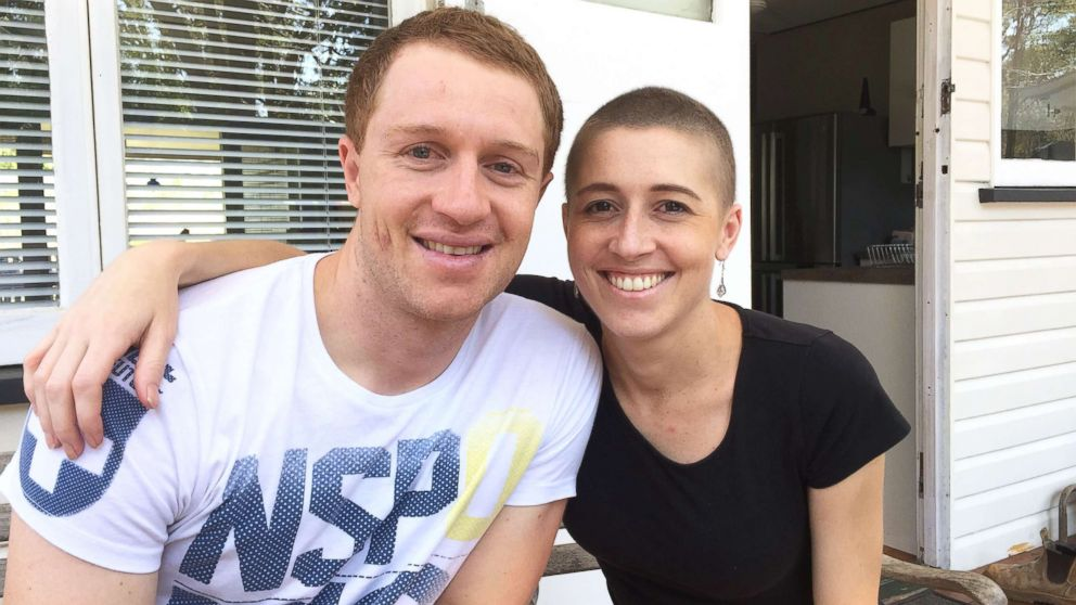 Holly Butcher, 27, poses with her 30-year-old brother, Dean, in this undated photo.