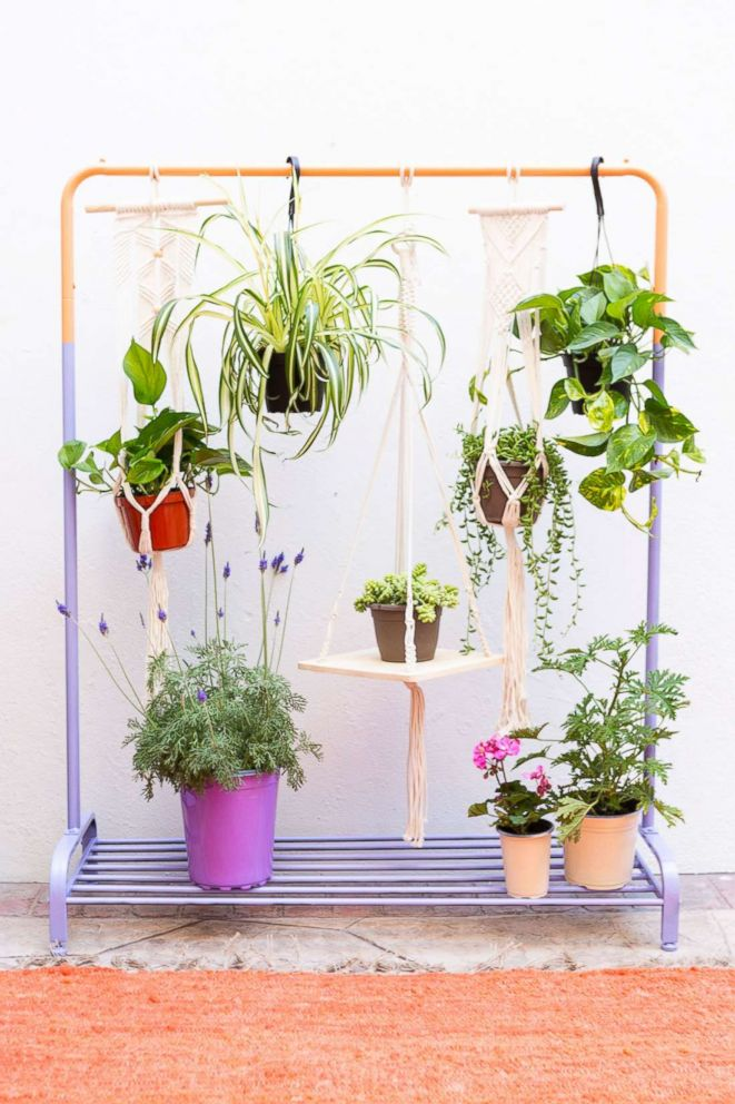 PHOTO: Learn step-by-step from Brit + Co how to make a bar out of cinder blocks and a clothing rack planter.