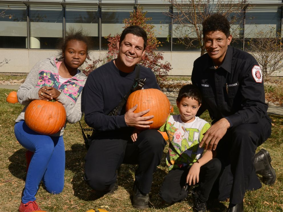 PHOTO: Two children pick pumpkins outside of Childrens Hospital Colorado as the community of Aurora marks the 11th year of setting up a pumpkin patch on the hospitals front lawn so the children wouldnt miss out on Halloween festivities, Oct. 25, 2017.