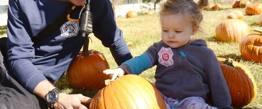 PHOTO: Two-year-old Ivy Page hunts for a pumpkin outside Childrens Hospital Colorado in Aurora, where she is being treated for neuroblastoma, Oct. 25, 2017.