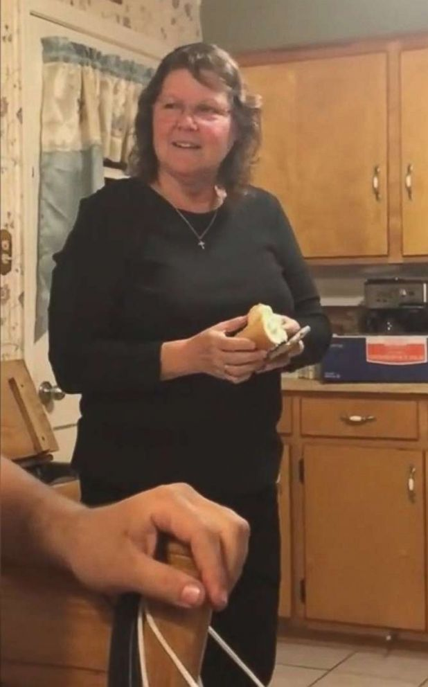 PHOTO: Cynthia Dozier holds a hot dog bun her son and daughter-in-law put in an oven to reveal their pregnancy.