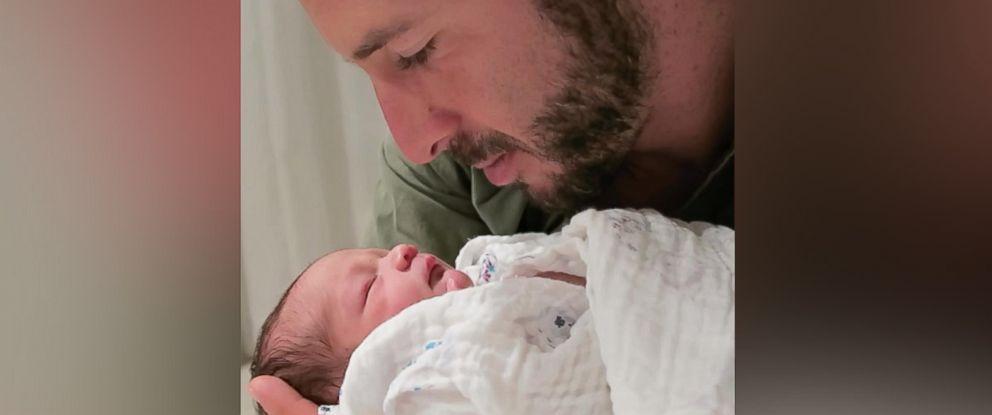 PHOTO: First-time father Daniel Eisenman quieted his crying daughter, Divina, in a now viral video.