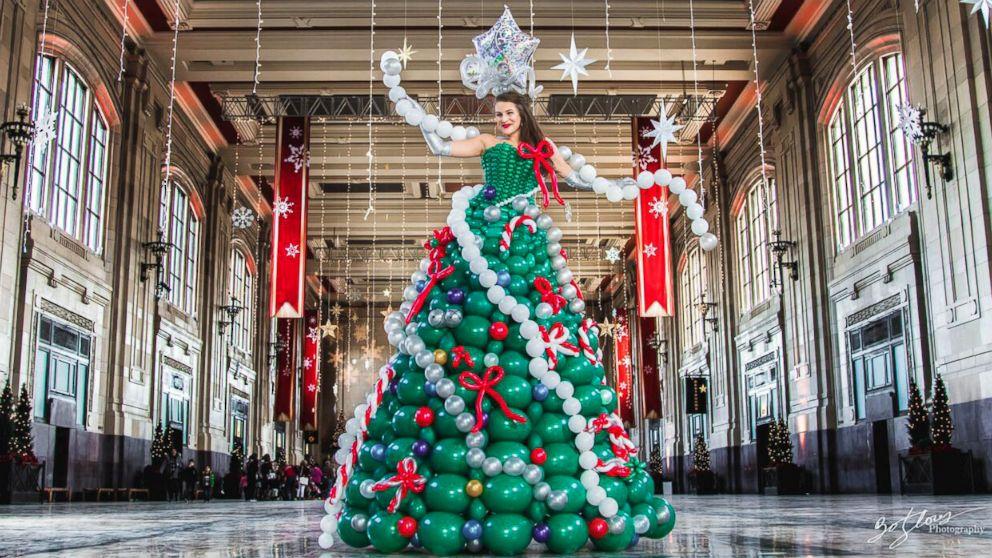 """Molly Balloons,"" of Kansas City, made an elaborate Christmas tree dress out of balloons."