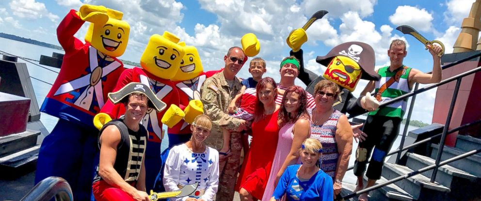 PHOTO: The Cruz and Collier families with Lego soldiers after Sgt. Tom Cruz surprised everyone on July 4 at Legoland in Florida.