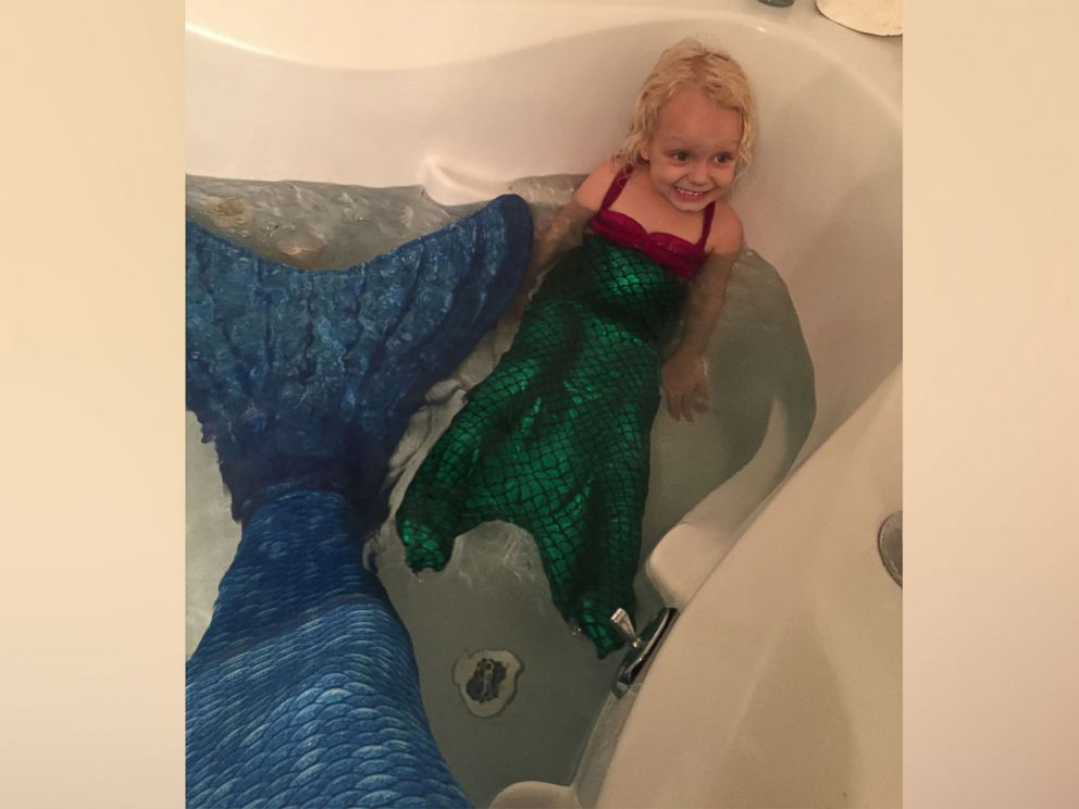 PHOTO: Keegan Carnahan, of Tampa, Florida, and 3-year-old Alidy Clark had a blast playing with their mermaid tails in the bath tub.