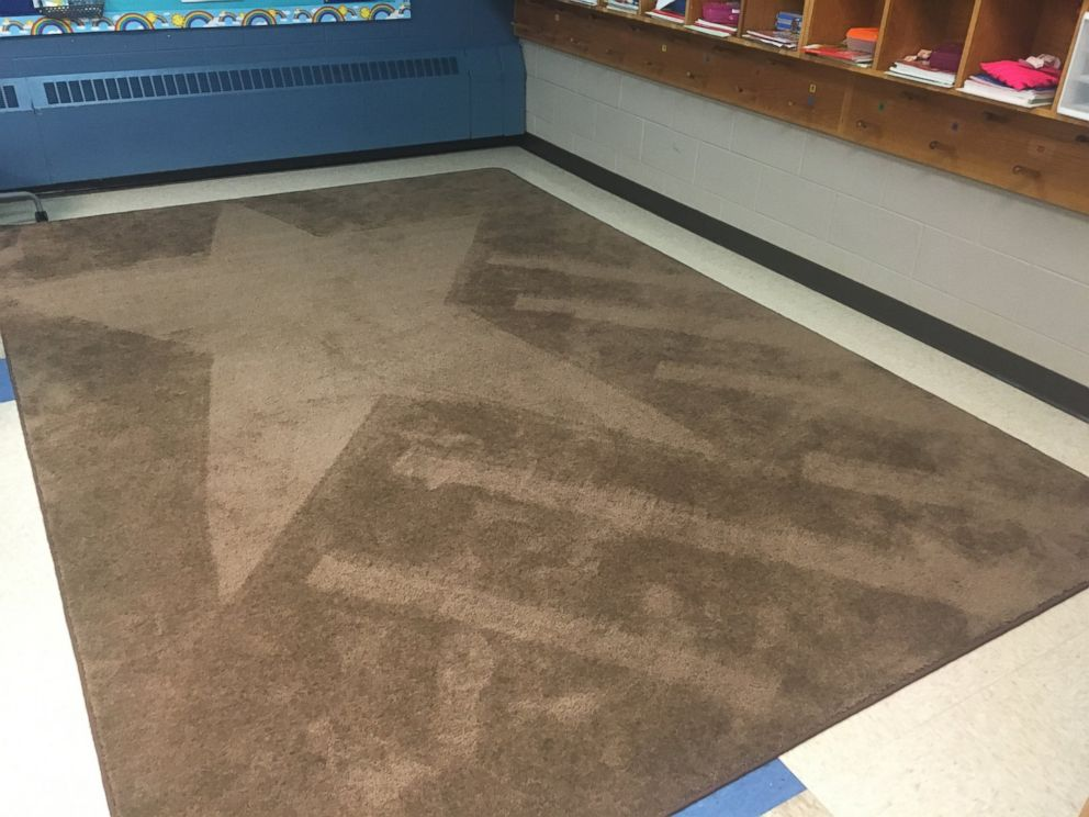 PHOTO: School janitor Ron Munsey vacuums artistic designs into classroom rugs as daily surprise for kids.