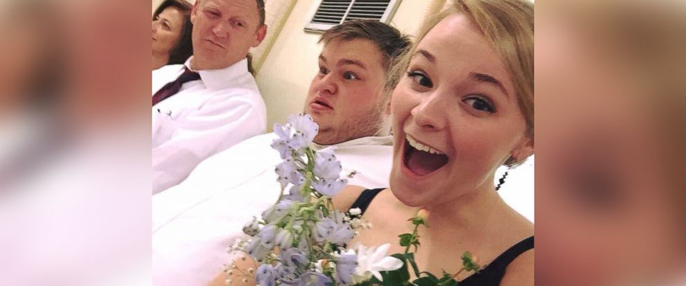 PHOTO: Ashley Stevens, right, taking a selfie with her father, left and boyfriend Christopher Reed, middle.