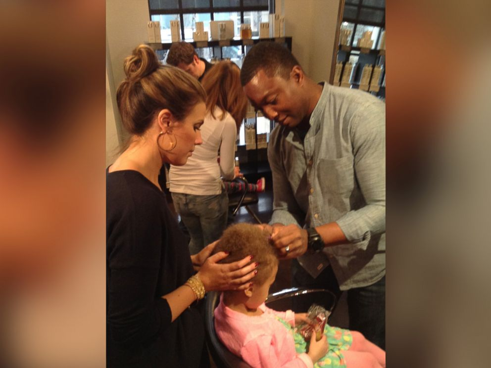 PHOTO: Owner Calli Huebl-Bodilis offers a beer and braids class at her Denver salon for dads.