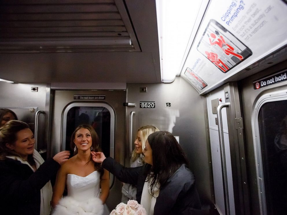 PHOTO: When a travel ban was put in place due to the inclement weather on Jan. 23, 2016, bride Ashley Burlage and her wedding party took the subway to the ceremony.