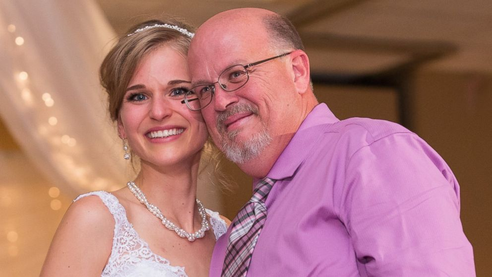 Greta Hokanson of Minnetonka, Minn. pictured at her wedding on Oct. 10, 2015, with Danny Daniels, the man who saved her life with his bone marrow donation in 2007.
