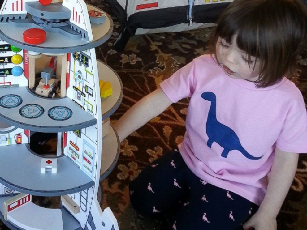 PHOTO: A girl wears a buddingSTEM shirt and leggings in the dinosaur print.