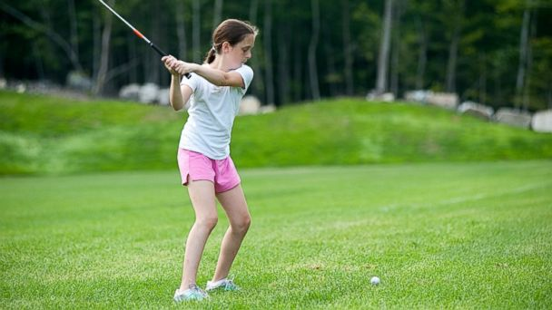 PHOTO: A camper plays golf at Camp Mataponi on Sebago Lake in Maine.
