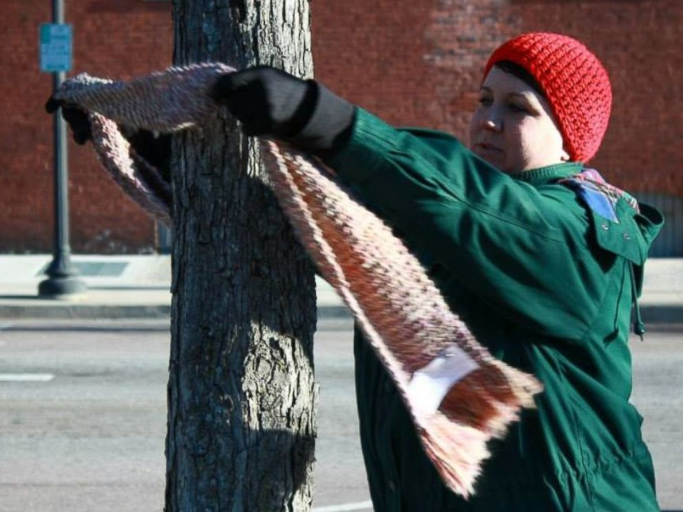 PHOTO: Carrie Sexton ties a scarf to a tree during her Chase the Chill of Central GAs first event.
