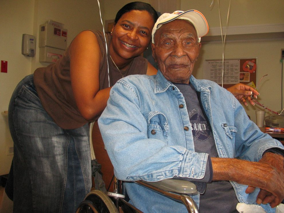 PHOTO: Chenise L. Williams with her grandfather, Albert Patrick, who taught her the importance of voting.