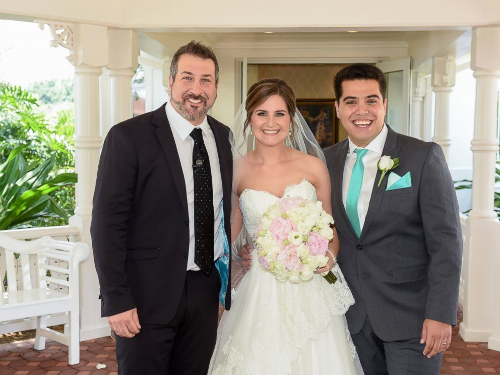 PHOTO: Joey Fatone poses with newlyweds after their Disney Fairytale wedding in Orlando.