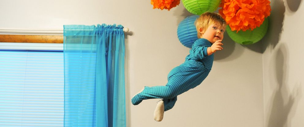 """PHOTO: Wil Lawrence is a 18-month-old toddler with Down syndrome. He is the subject of a photo series his dad, Alan Lawrence, created. Lawrence says Wil will be able to do anything he wants in life, even """"fly."""""""