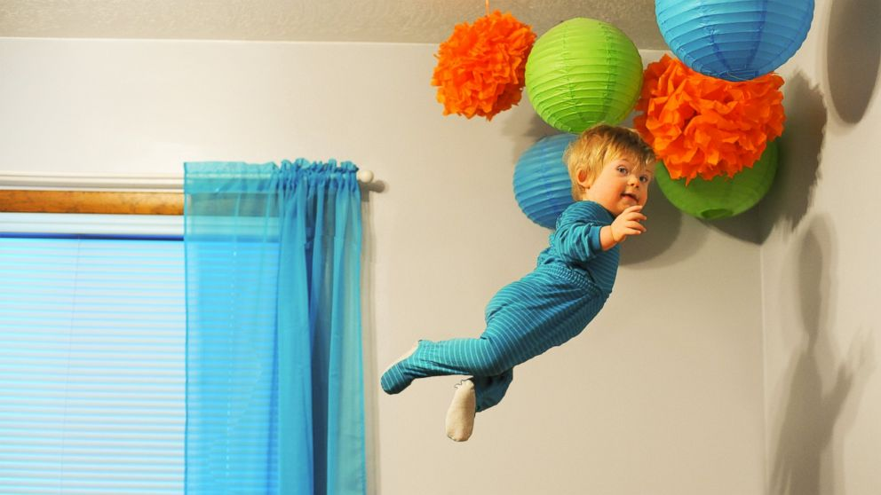 """Wil Lawrence is a 18-month-old toddler with Down syndrome. He is the subject of a photo series his dad, Alan Lawrence, created. Lawrence says Wil will be able to do anything he wants in life, even """"fly."""""""