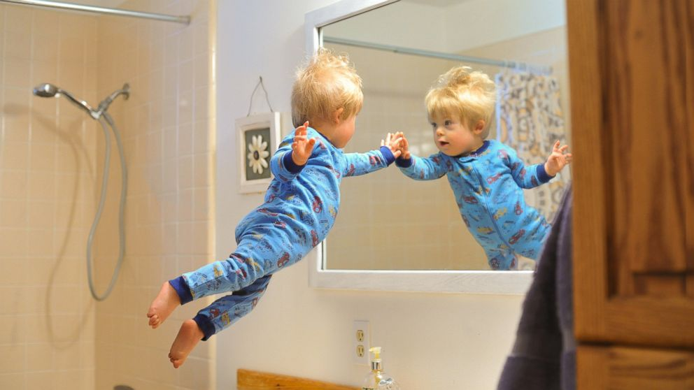 Wil checks himself out in the mirror first thing in the morning.