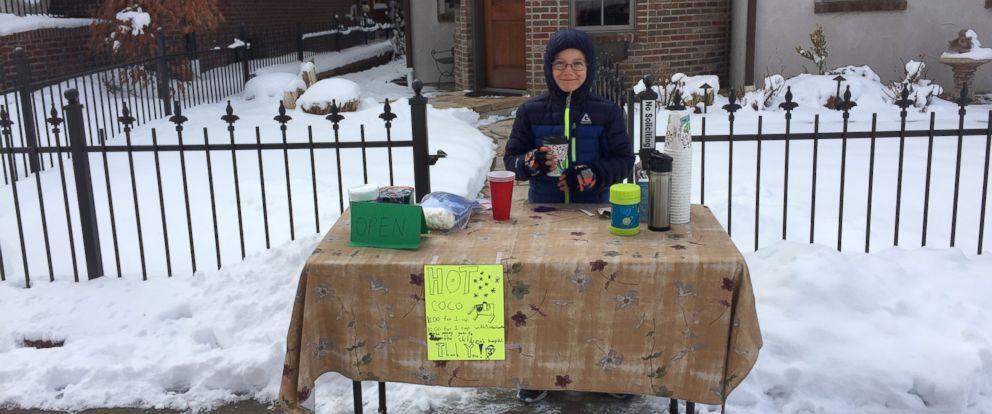 PHOTO: Tristan Regini, 8, opened a hot cocoa stand at his Denver, Colorado, home to raise money for Childrens Hospital Colorado.