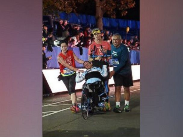 PHOTO: Kyle and Brent Pease completed the 2015 New York City marathon thanks to the assistance of two runners who helped carry Kyle to the finish line.