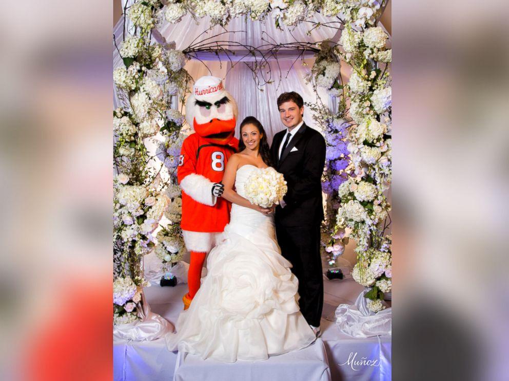 PHOTO: Jennifer Sullivan walked down the aisle on the arm of Miami Hurricanes mascot Sebastian.