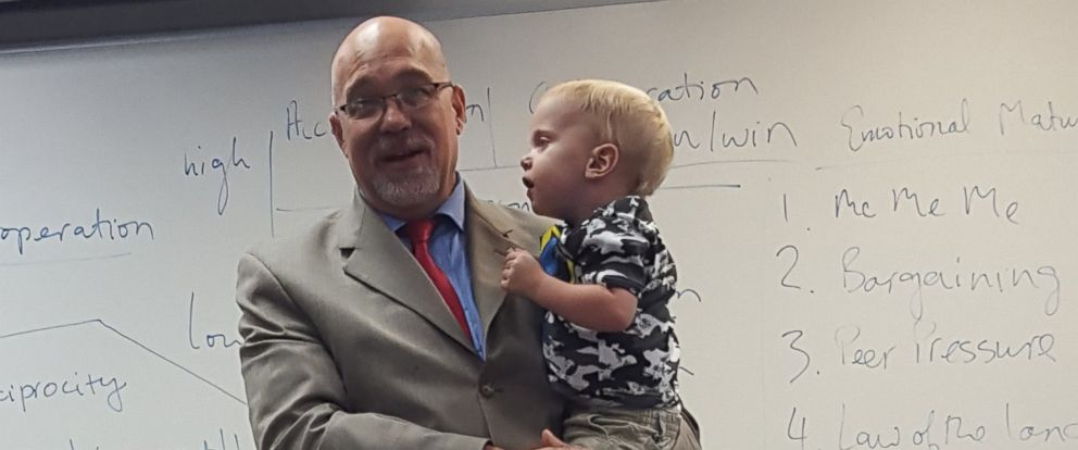 PHOTO: Amanda Osbon snapped a photo of her college professor holding her son during a class lecture on September 21.