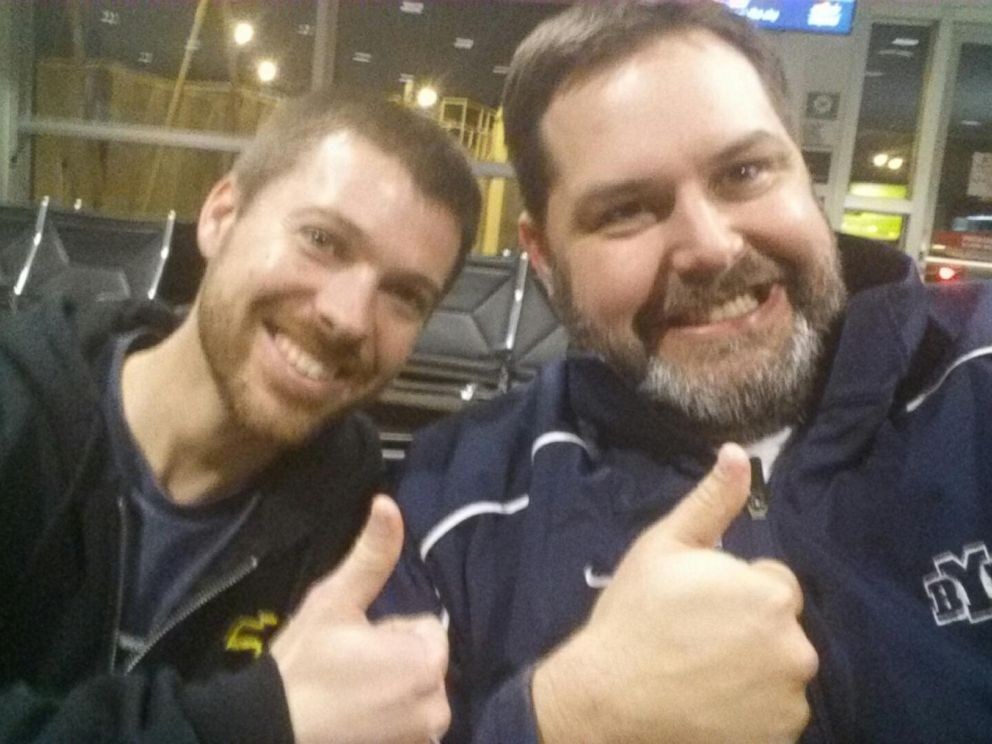 PHOTO: Government workers Matt Brown and Lance Magnusson share smiles in make-up selfie.