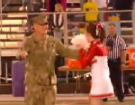 PHOTO: Petty Officer Dale Williams hid behind the Color Guard before surprising his daughter, Kendall at the Erwin High Schools John G. Kerr Stadium in Asheville, NC.