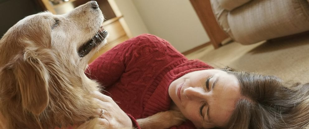 """PHOTO: Owner Bev is pictured with her dog """"Suzie."""""""