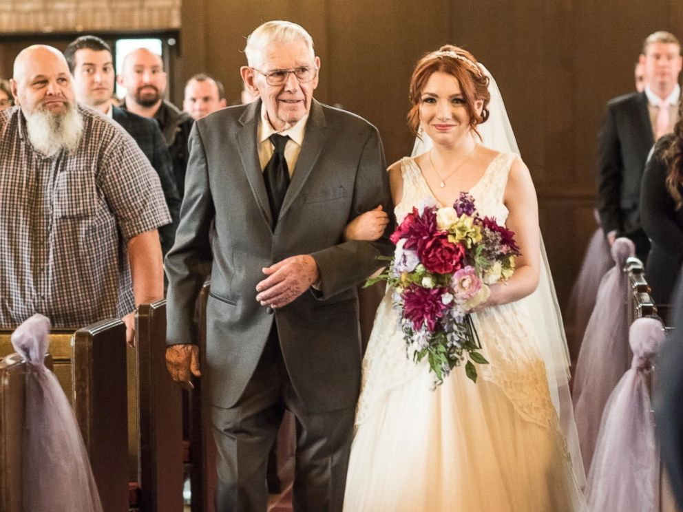 PHOTO: Grandfather Walks 3 Generations of Women Down the Aisle in Same Dress