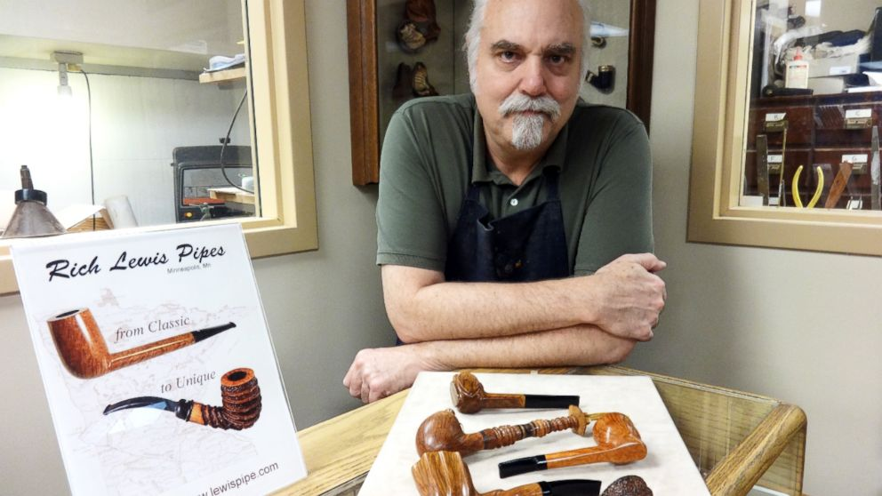 Richard Lewis with a display of hand crafted pipes at his Minneapolis tobacco shop.