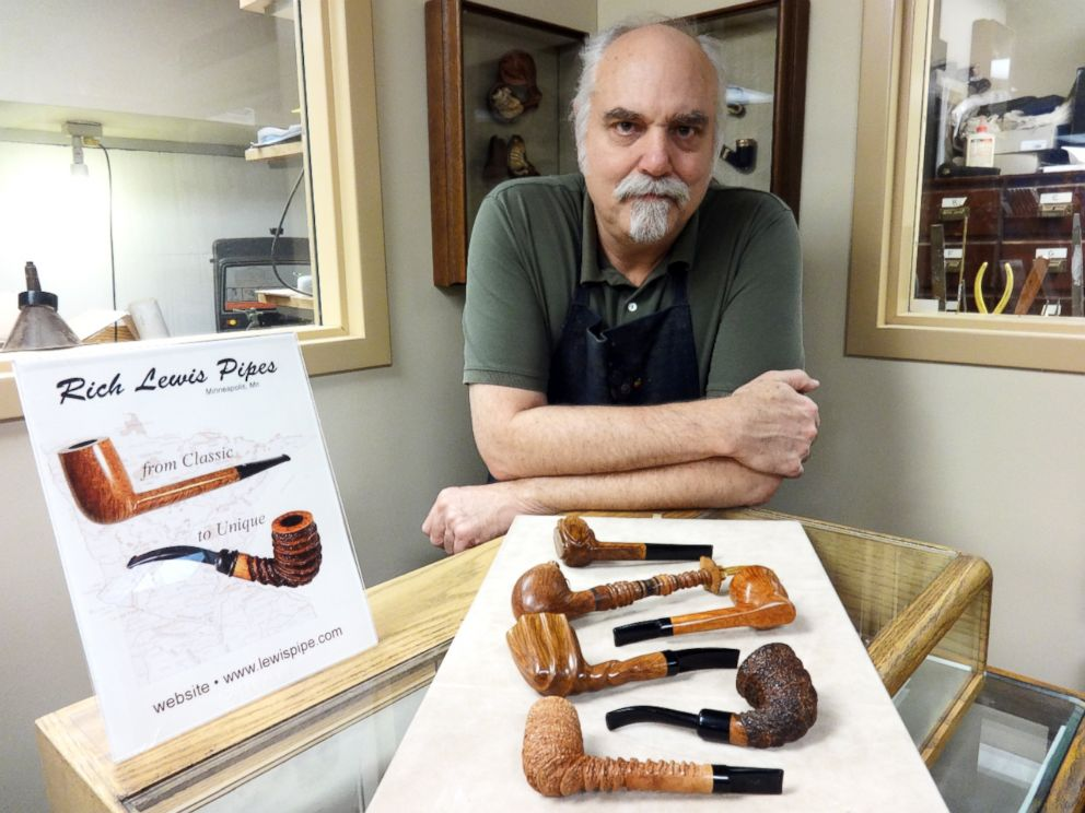 PHOTO: Richard Lewis with a display of hand crafted pipes at his Minneapolis tobacco shop.