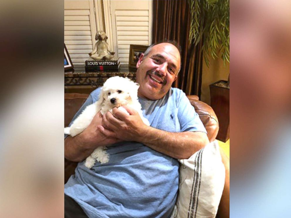 PHOTO: James Xuereb of Ontario was overcome with emotion when his family surprised him with a new bichon frise puppy after he recently lost two of his beloved dogs.