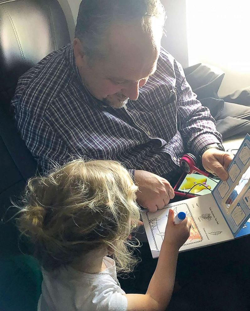 PHOTO: Todd Walker, 52, of Lenexa, Kansas, seen on April 10 coloring with Caroline Rudeen, 3, on a flight from Kansas City, Missouri, to North Carolina.