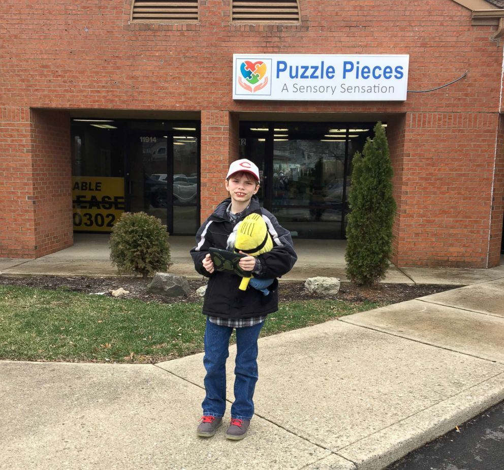PHOTO: Parker Kahle, 13, stands near the storefront of Puzzle Pieces - A Sensory Sensation, in an undated photo.