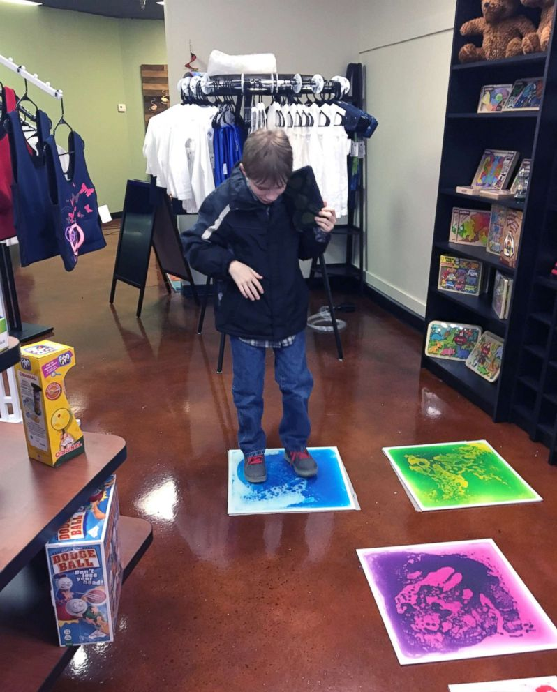 PHOTO: Parker Kahle, 13, enjoys an activity inside the Puzzle Pieces toy shop in Ohio.