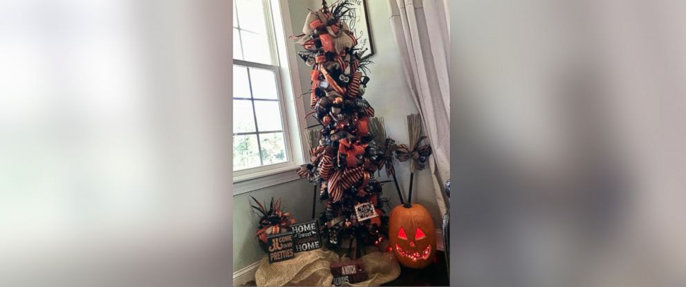 PHOTO: Kandi Jung, owner of Kandis Kreations, decorated a Halloween tree with pumpkins, bows and burlap.
